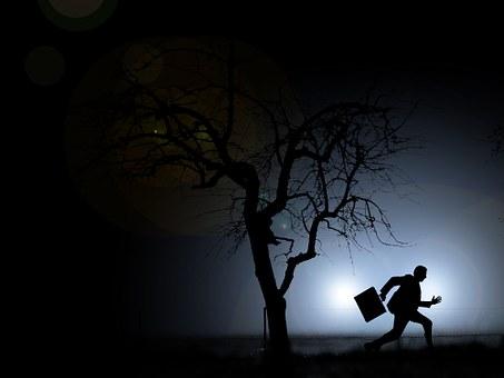 Night scene guy running away